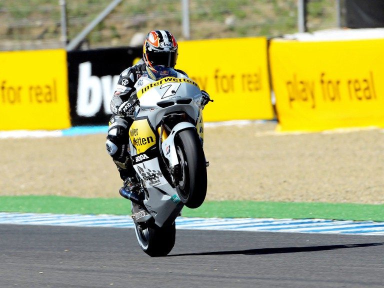 Hiroshi Aoyama pulls off a wheelie after the QP in Jerez