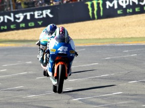 Pol Espargaró riding ahead of Nico Terol at the finish of the race in Le Mans