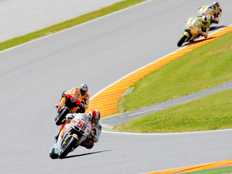 Marco Simoncelli riding ahead of Dovizioso in Mugello
