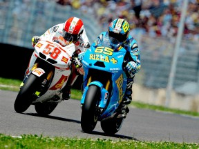 Capirossi and Simoncelli riding head to head during the race in