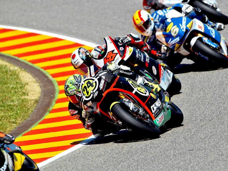 Toni Elias riding ahead of Moto2 group in Mugello