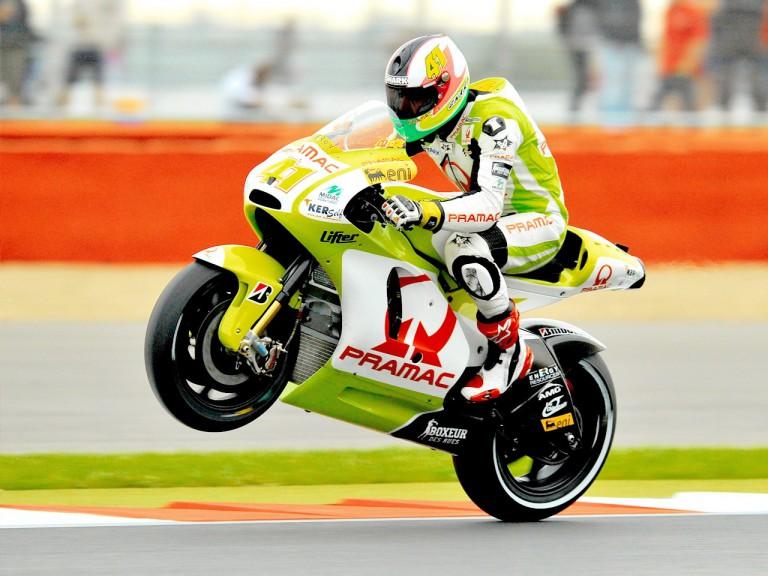 Aleix Espargaró pulls off a wheelie at Silverstone