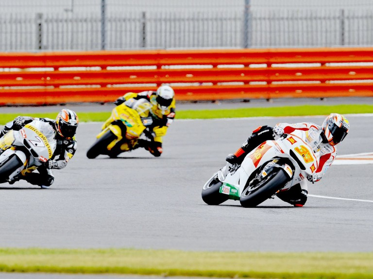 Melandri riding ahead of Aoyama and Barberá at Silverstone