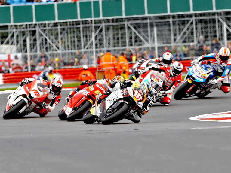 Jules Cluzel riding ahead of Moto2 group during the race at Silverstone