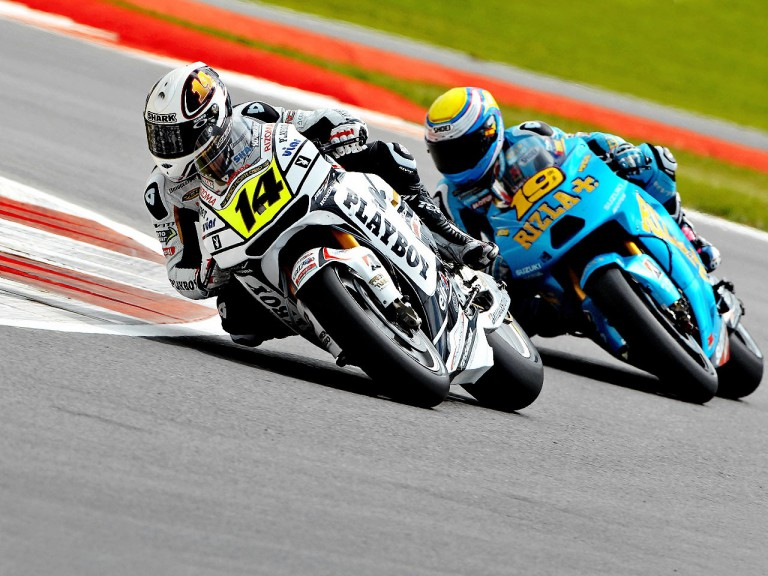 Randy de Puniet riding ahead of Bautista at Silverstone