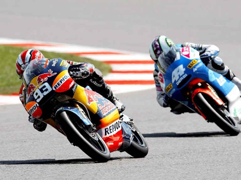 Marquez riding ahead of Espargaró during the 125cc race at Silverstone