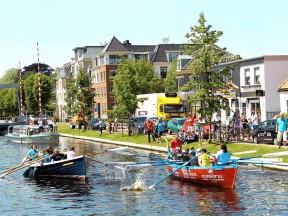 MotoGP riders and TV journalists take part in a boat race along the Assen canals