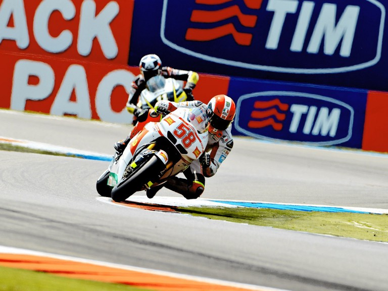 Simoncelli riding ahead of Spies in Assen