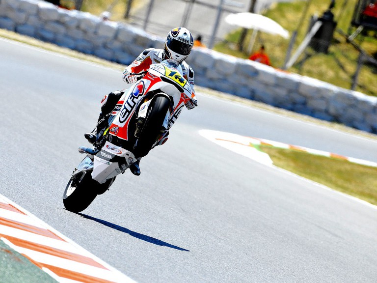 Randy de Puniet pulls off a wheelie during FP1 at the Catalunya Circuit