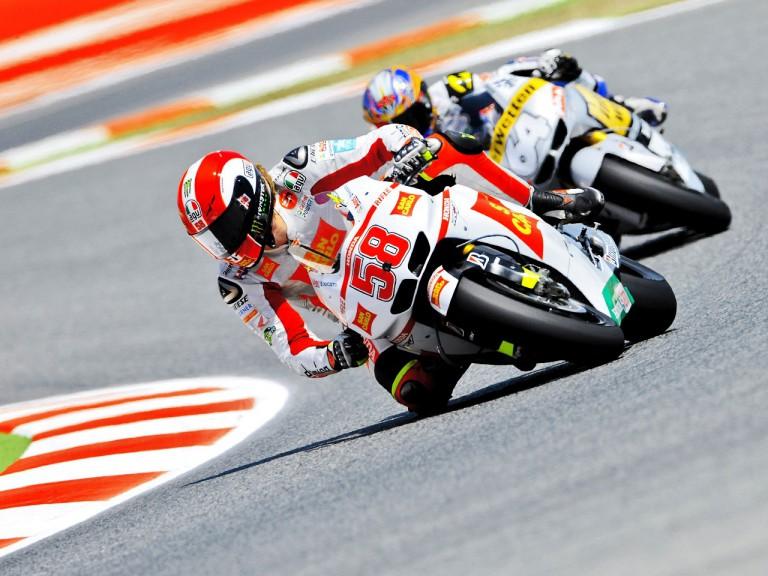 Simoncelli riding ahead of Akiyoshi at the Catalunya Circuit