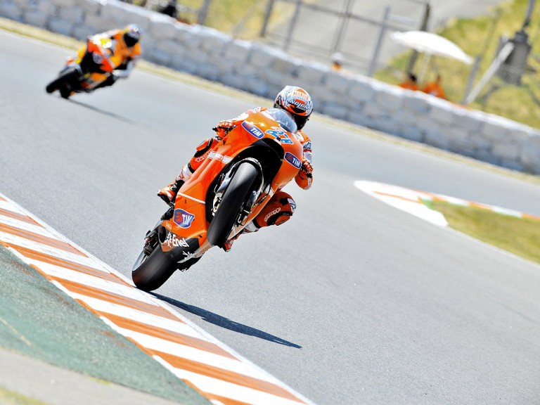 Stoner pulls off a wheelie during FP1 at the Catalunya Circuit