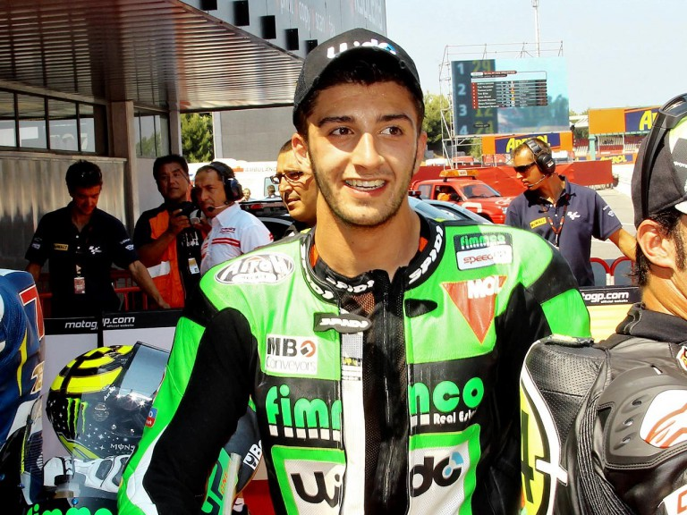 Andrea Iannone in the parc fermé at the Catalunya Circuit