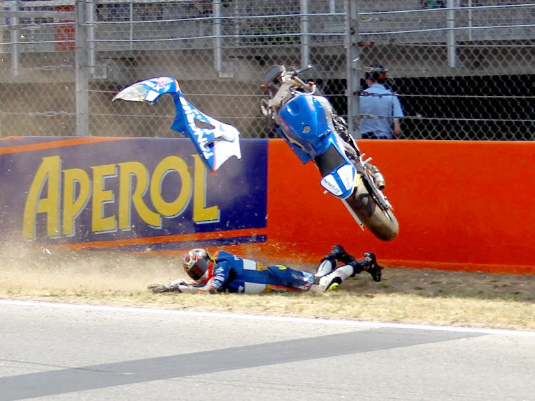 Carmelo Morales crashes during the Moto2 Race at the Catalunya Circuit