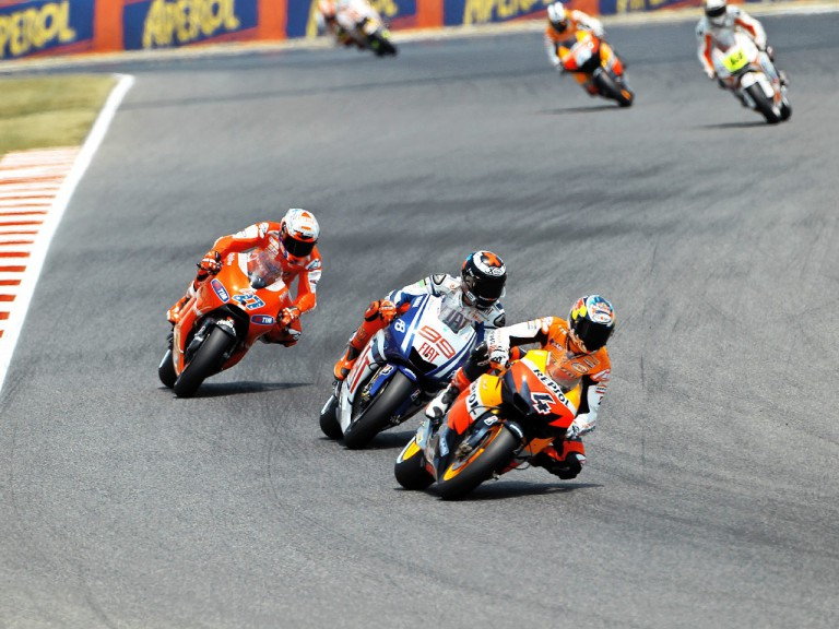 Dovizioso riding ahead of Lorenzo and Stoner at the Catalunya Circuit