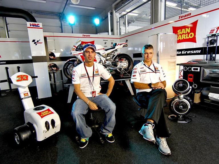 Marco Melandri and Antonio Jimenez in the San Carlo Honda Gresini garage