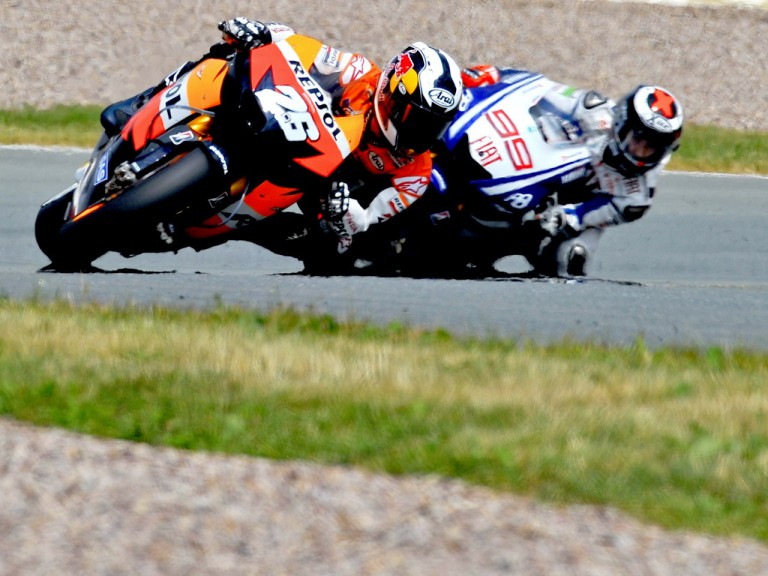 Pedrosa riding ahead of Lorenzo during the race in Sachsenring