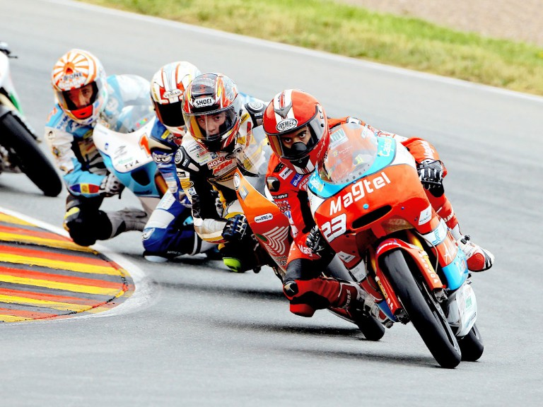 Alberto Moncayo riding ahead of 125cc group in Sachsenring
