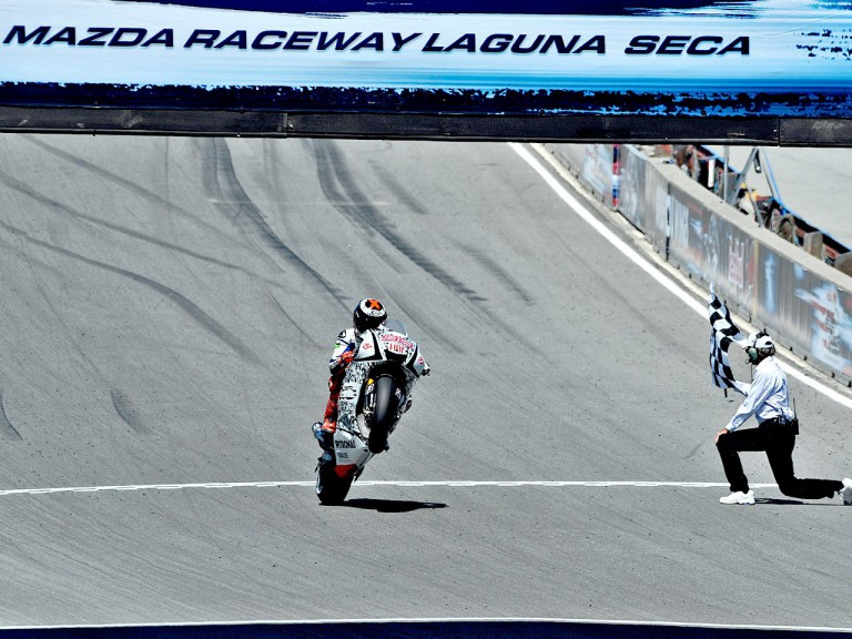 Jorge Lorenzo pulls off a wheelie at the finish of the race in Laguna Seca