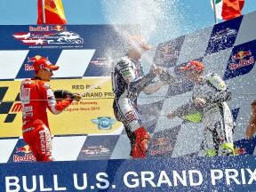 Stoner, Lorenzo and Rossi celebrates GP win on the podium in Laguna Seca