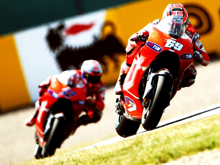 The ducati riders Nicky Hayden and Casey Stoner in action