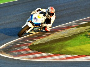 Mattia Pasini riding on track