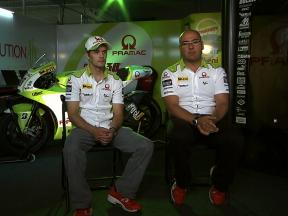 Mika Kallio and his crew chief discuss Pramac Racing's Ducati GP10