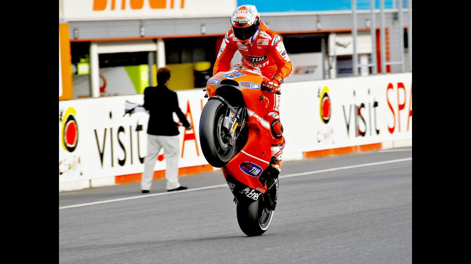 Casey Stoner pulls off a wheelie after the race at Motegi
