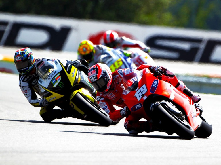 Nicky Hayden riding ahead Colin Edwards