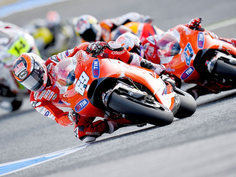 Nicky Hayden riding ahead of Stoner at Estoril