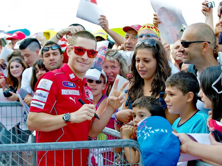 Nicky Hayden attending fans at the paddock in Misano