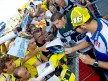 Valentino Rossi attending fans at the paddock in Misano