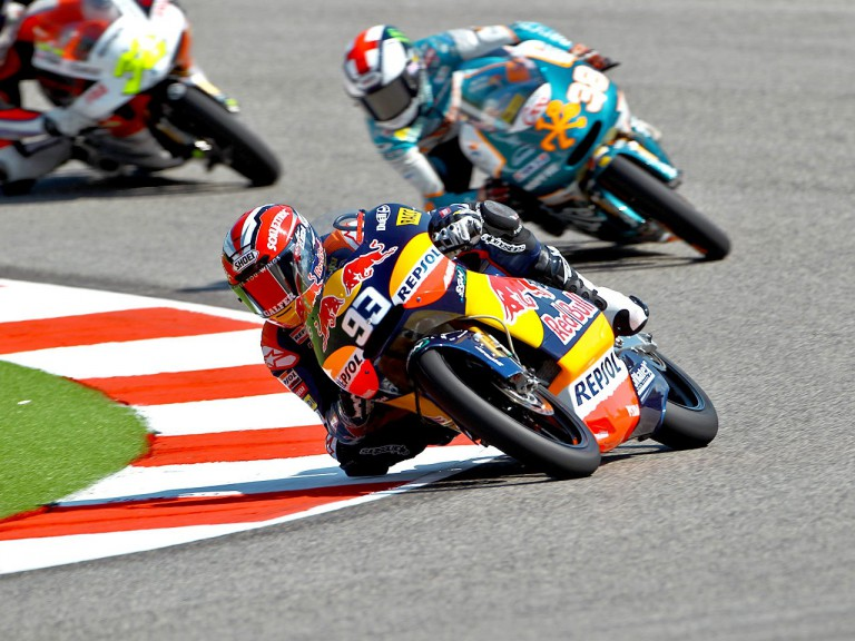 Marquéz riding ahead of Smith at Misano