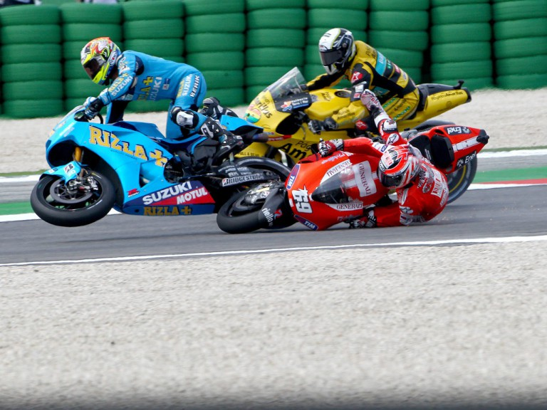 Capirossi and Hayden crash during the race at Misano