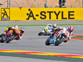 Marco Simoncelli riding ahead of MotoGP Group at Motorland Aragón