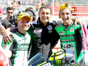 Talmacsi, Boscoscuro and Iannone at the parc fermé after Moto2 race at Motorland Aragón