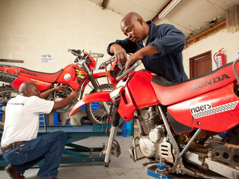 Riders for Health technicians working on bikes