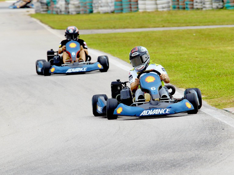 Mika Kallio riding ahead of Corti during the Kart race at Sepang