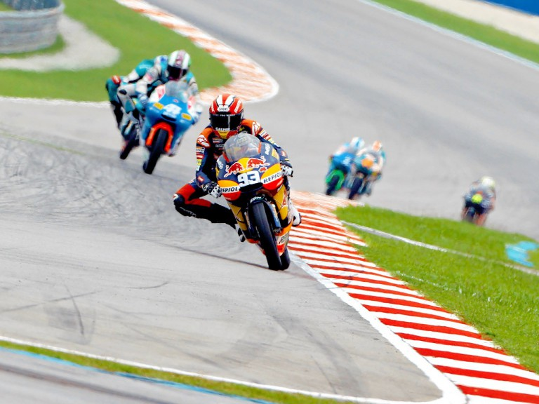 Marc Marquez riding ahead of 125cc group at Sepang