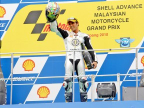 2010 Moto2 World Champion Toni Elías on the podium at Sepang