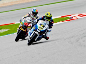 Roberto Rolfo riding ahead of Alex de Angelis at Sepang