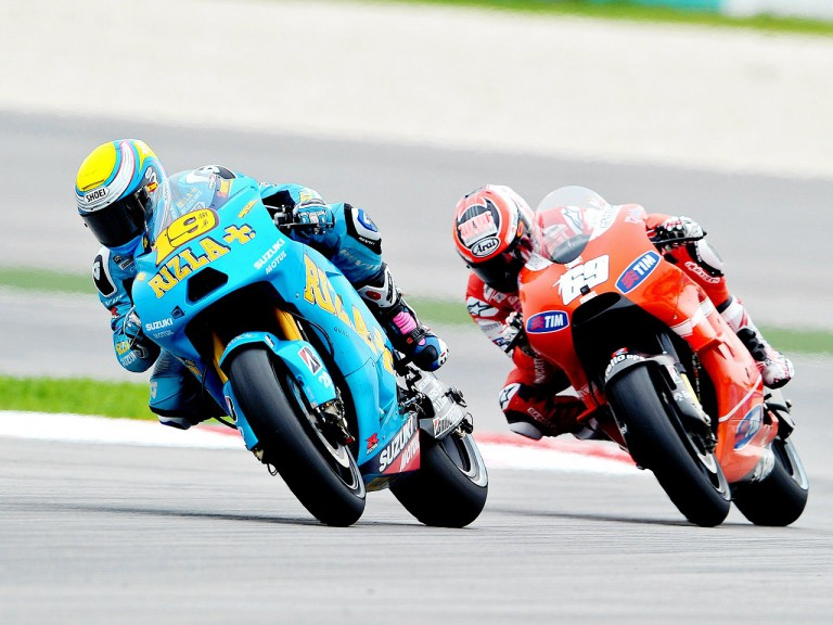 Bautista riding ahead of Hayden at Sepang