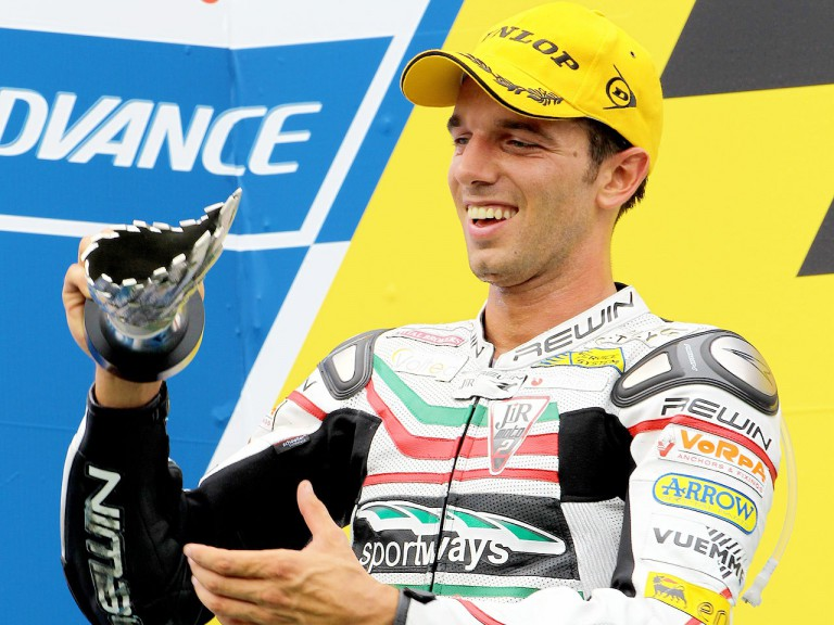 Alex de Angelis on the podium at Sepang
