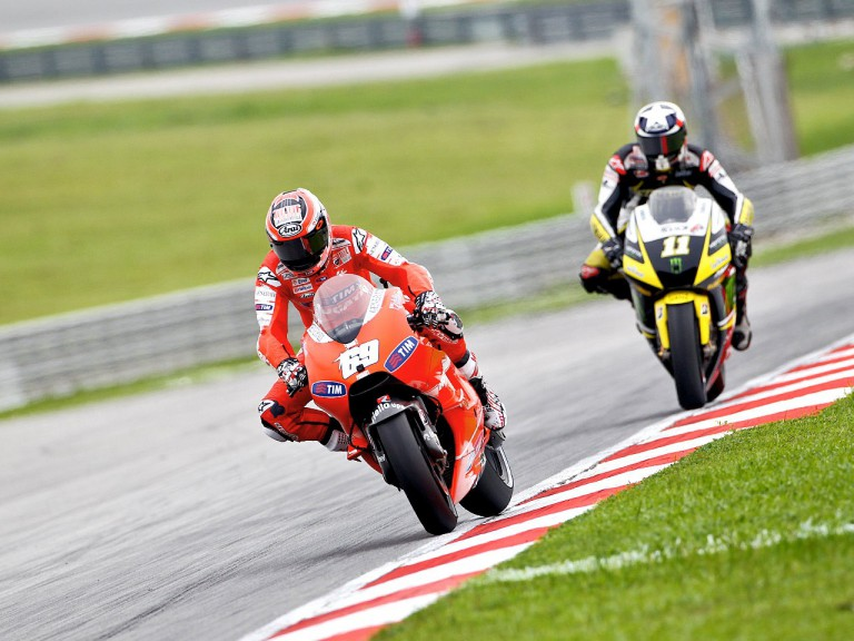 Nicky Hayden riding ahead of Spies at Sepang