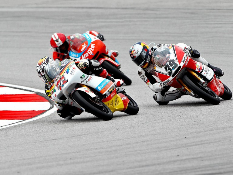 Koyama riding ahead of Salom at Sepang