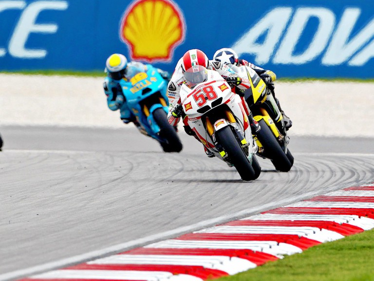 Simoncelli riding ahead of Spies and Bautista at Sepang