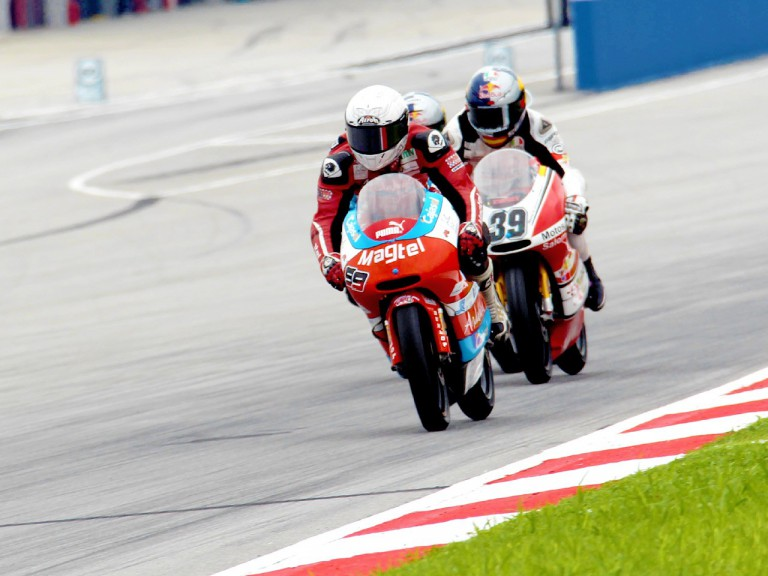 Danny Webb riding ahead of Luis Salom at Sepang