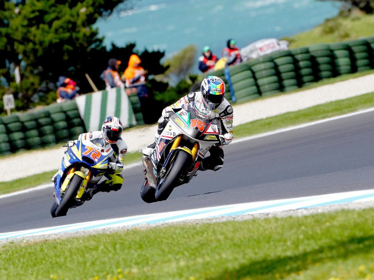 Alex de Angelis riding ahead of Takahashi at Phillip Island
