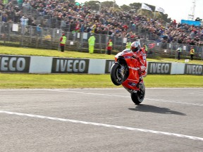 Casey Stoner pulls off a wheelie at Phillip Island