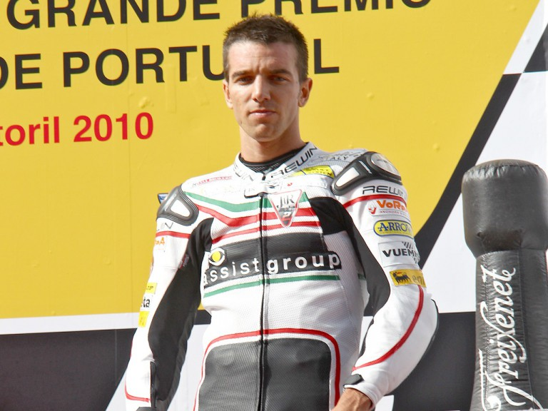 Alex de Angelis on the podium at Estoril