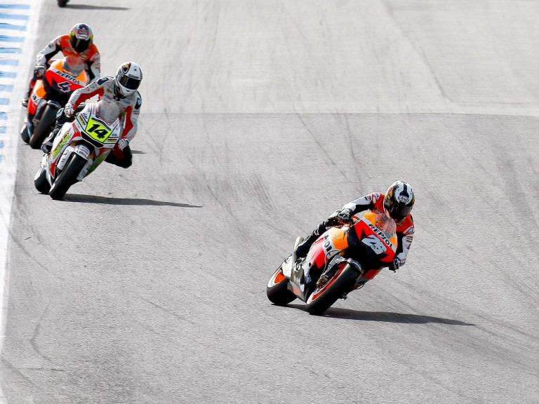 Pedrosa riding ahead of De Puniet and Dovzisioso at Estoril